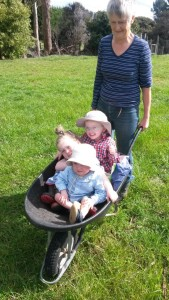 Jane taking the Grandchildren for a ride across the farm